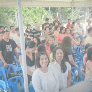 people_attending_holy_mass_outside_the_church